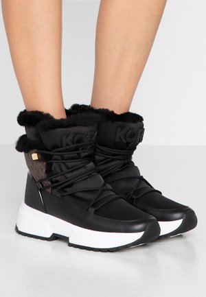 CASSIA BOOTIE - Kotníkové boty na platformě - black/brown