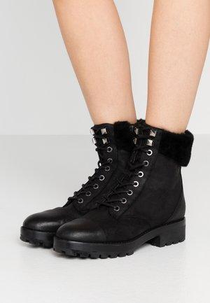 CRAMER BOOT - Platform ankle boots - black