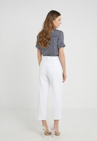 MICHAEL Michael Kors - STRAIGHT - Trousers - white - 2