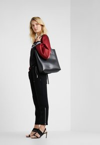 MICHAEL Michael Kors - SPORTY ZIP PANT - Jogginghose - black - 1