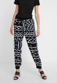 MICHAEL Michael Kors - LOGO TRACK PANT - Pantalones - black/white - 0