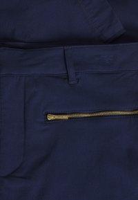 MICHAEL Michael Kors - SKINNY ZIP - Spodnie materiałowe - true navy - 2