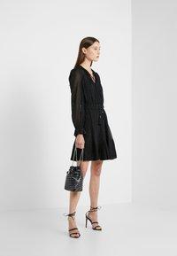 MICHAEL Michael Kors - TASSEL PLEAT - Day dress - black - 1
