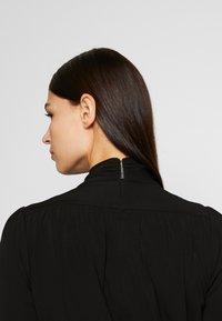 MICHAEL Michael Kors - TIE NECK MINI DRESS - Etui-jurk - black - 4