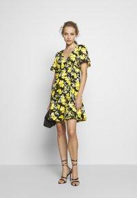 MICHAEL Michael Kors - TROP SQN FLARE DRESS - Day dress - black/bright dandelion - 1