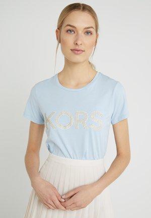 T-shirt med print - pastel blue