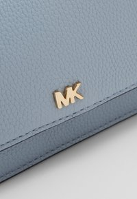 MICHAEL Michael Kors - PHONE CROSSBODY - Clutch - pale blue
