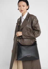 MICHAEL Michael Kors - ARIA PEBBLE  - Handbag - black - 1
