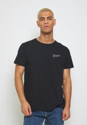 CAUGHT - Print T-shirt - black