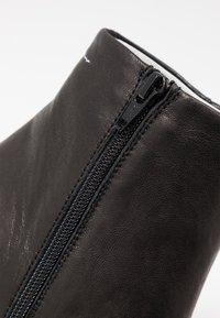MM6 Maison Margiela - High heeled ankle boots - black - 2