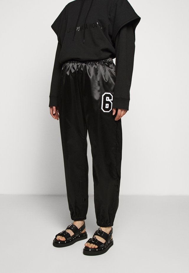 TRACK PANT - Trousers - black