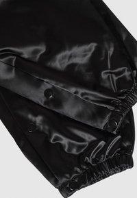 MM6 Maison Margiela - TRACK PANT - Kalhoty - black - 3