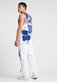 Mitchell & Ness - NBA ALL STAR EAST 1991 WARM UP PANT - Trainingsbroek - white - 2