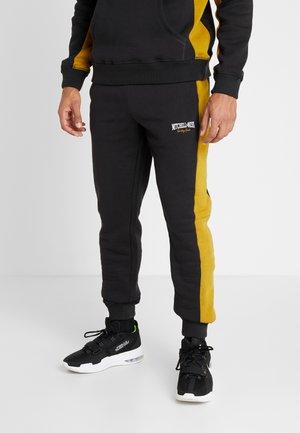PANELED - Teplákové kalhoty - black