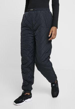 PETAL PADDED PANTS - Tygbyxor - black