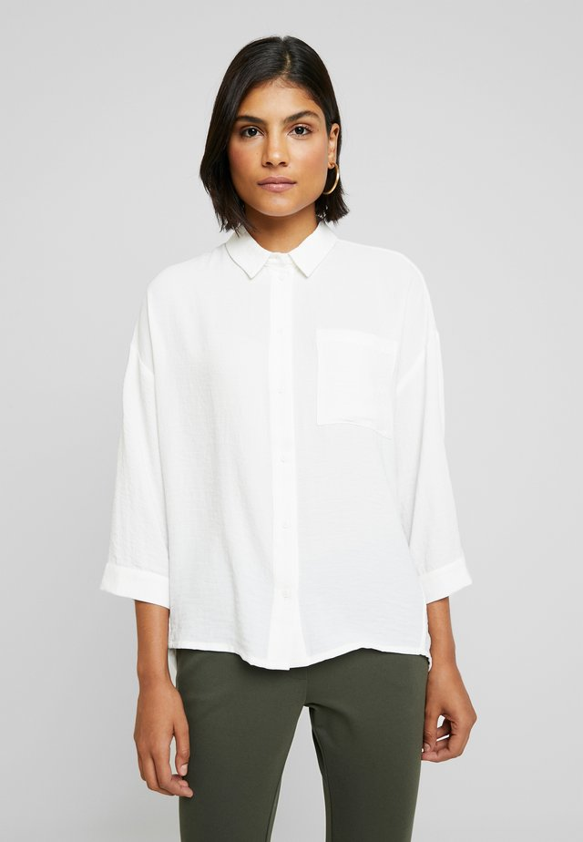 ALEXIS - Button-down blouse - off white