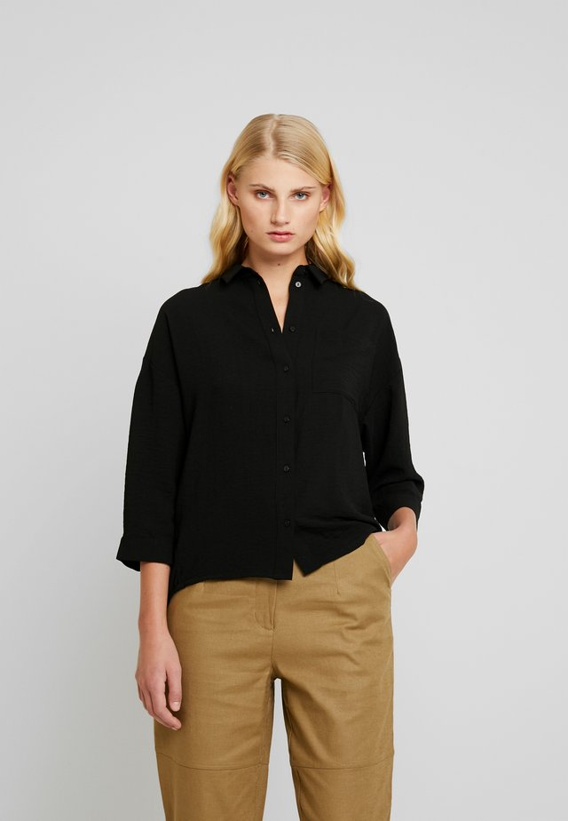ALEXIS - Button-down blouse - black