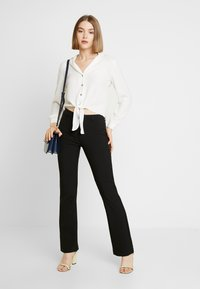 Moves - SASSY - Trousers - black - 1