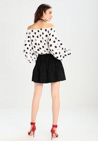 Moves - KIA - Áčková sukně - black - 2