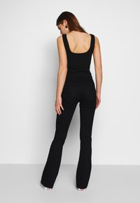 Moves - HANNIA - Flared Jeans - black - 0
