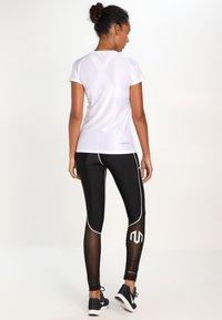 MOROTAI - PERFORMANCE DUAL - Leggings - black - 2
