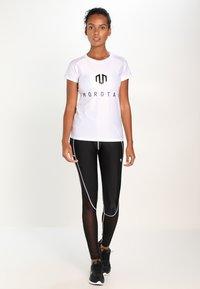 MOROTAI - PERFORMANCE DUAL - Leggings - black - 1