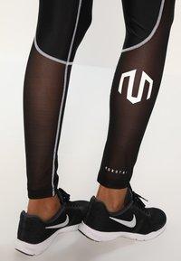 MOROTAI - PERFORMANCE DUAL - Leggings - black - 5