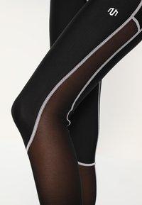 MOROTAI - PERFORMANCE DUAL - Leggings - black - 4