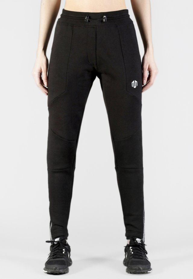 COMFY PERFORMANCE - Tracksuit bottoms - black