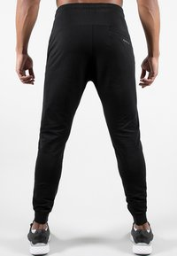 MOROTAI - NKMR  - Tracksuit bottoms - black - 1