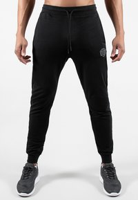 MOROTAI - NKMR  - Tracksuit bottoms - black - 0