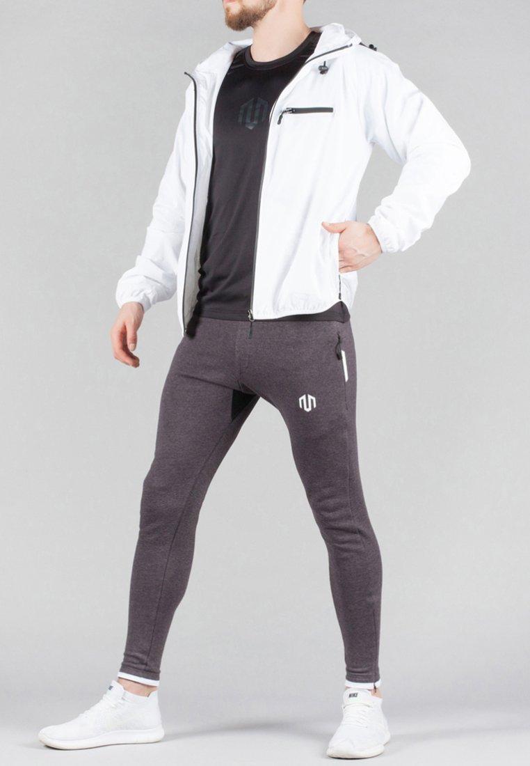 MOROTAI - Impermeable - white