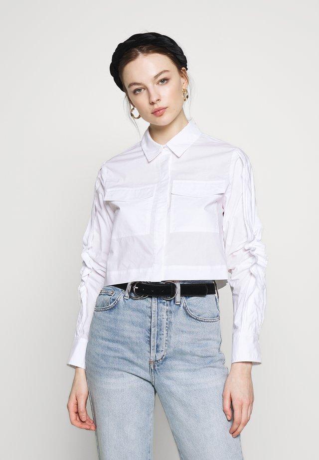 NEVER ENOUGH - Button-down blouse - white