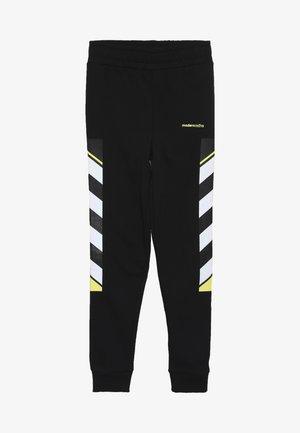 LOOPBACK WITH PRINTED SIDE - Teplákové kalhoty - black