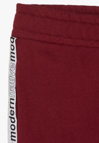 Modern Native - LOOPBACK WITH TAPING AND LOGO - Pantalones deportivos - burgundy - 2