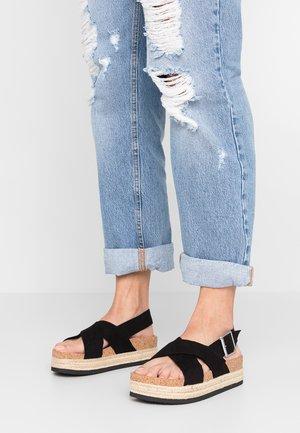 JANNIKE - Sandalen met plateauzool - black