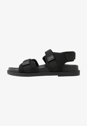 MISHA - Sandaalit nilkkaremmillä - black