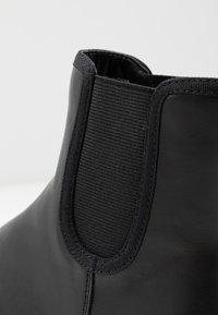 Monki - SASHA - Kotníkové boty na platformě - black - 2