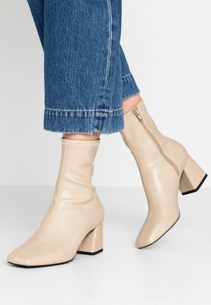 LEIA BOOT - Classic ankle boots - beige