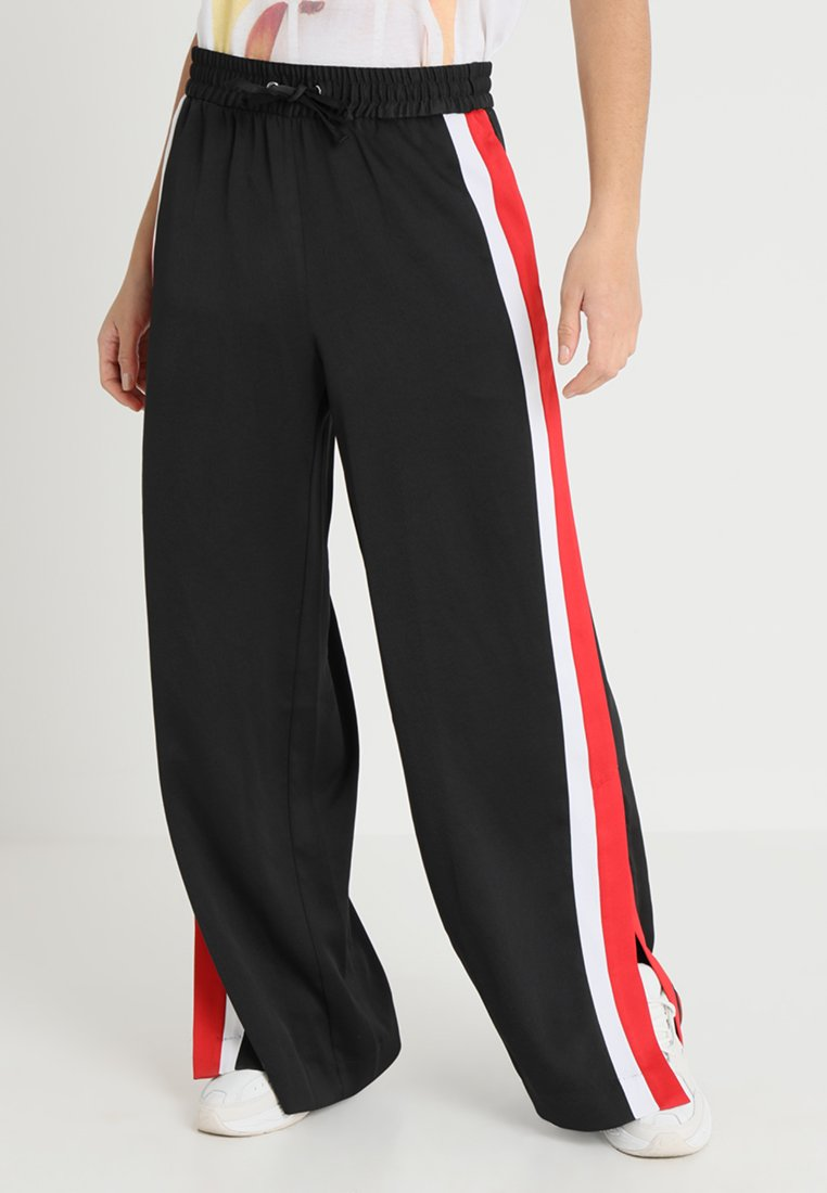 Monki - KLARA TROUSERS - Bukse - black with white and red
