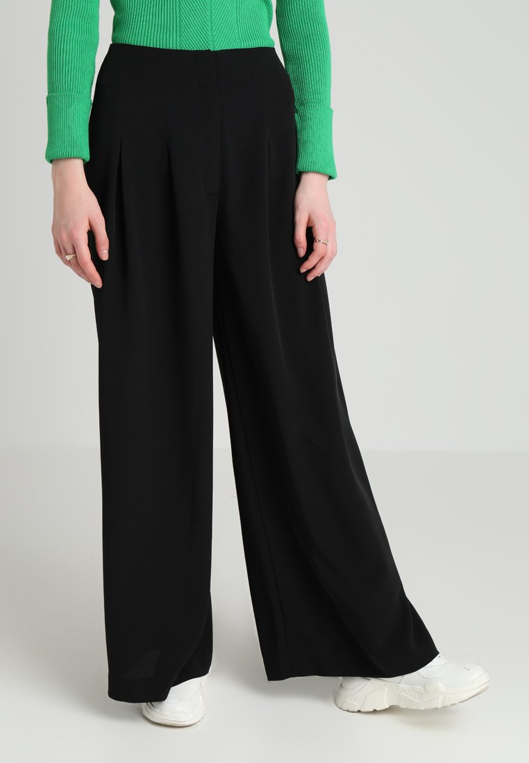 Monki - ELLI TROUSERS - Stoffhose - black