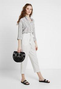 Monki - MAGGIS TROUSERS - Pantalones - white/black - 1
