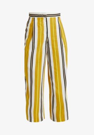 MALINKA TROUSERS - Pantalones - sporty mustard