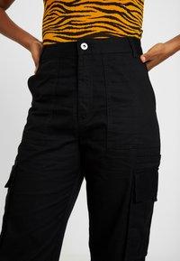 Monki - CAILYN TROUSERS - Pantaloni - black dark solid - 3