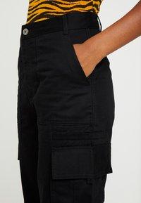 Monki - CAILYN TROUSERS - Pantaloni - black dark solid - 5