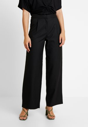 HALINA TROUSERS - Kangashousut - black
