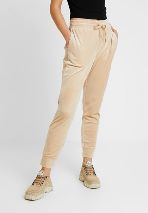 MIRRE TROUSERS - Tracksuit bottoms - beige