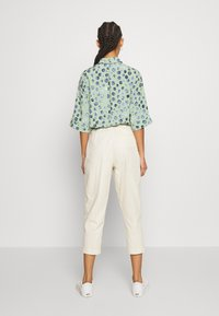 Monki - MONA TROUSERS - Trousers - white - 2