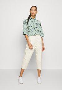 Monki - MONA TROUSERS - Trousers - white - 1