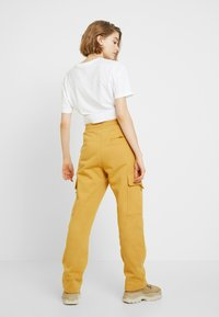 Monki - WILLOW - Tracksuit bottoms - camel - 2